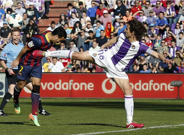 Barcelona's Rodriguez and Valladolid's Rubio fight for the ball during their Spanish first division soccer match in Valladolid