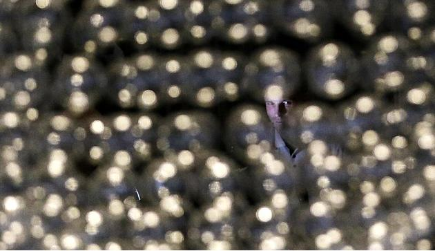 Heisman Trophy finalist Jordan Lynch, a quarterback at Northern Illinois, is seen through a light decoration at the Marriott Marquis in Times Square during an informal media availability, Friday, Dec.