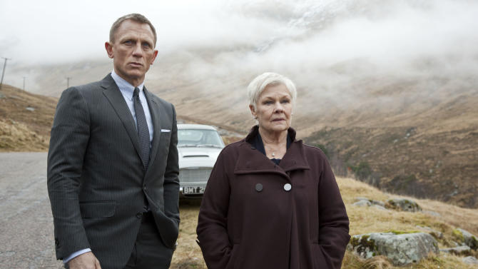 "This film image released by Sony Pictures shows Daniel Craig as James Bond, left, and Judi Dench as MI6 head M, in a scene from the film ""Skyfall."" Dench has been the Bond matriarch: the strong-willed, no-nonsense mainstay of feminine authority in a movie franchise that has, more often than not, featured slightly more superficial womanly traits. In ""Skyfall,"" Dench isn't just dictating orders from headquarters, but is thrown directly into the action when a former MI6 agent, played by Javier Bardem, is bent on revenge against her.   (AP Photo/Sony Pictures, Francois Duhamel)"