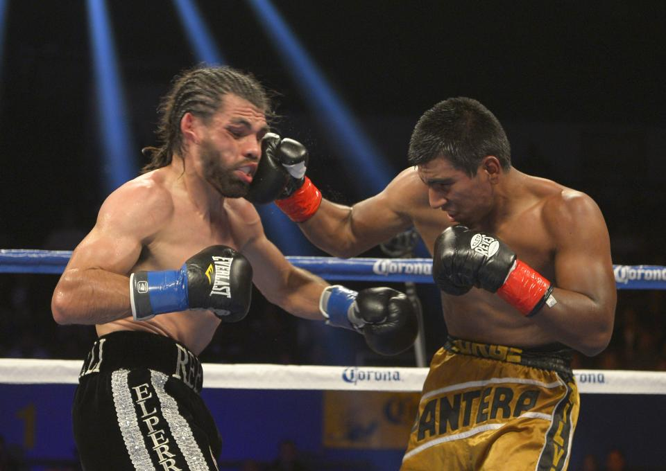 Jorge Silva, right, connects with Alfredo Angulo during their middleweight boxing bout, Saturday, Dec. 15, 2012, in Los Angeles. (AP Photo/Mark J. Terrill)