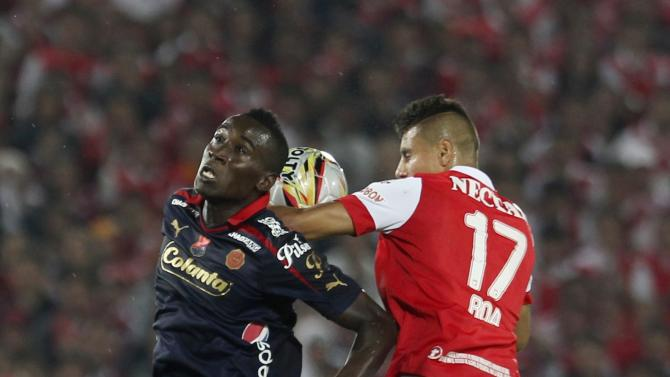 Juan Daniel Roa of Colombia's Santa Fe fights for ball against Yorleys Mena of Colombia's Medellin during Colombian first division championship in Bogota
