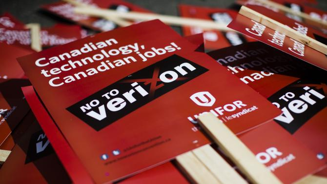 File of a pile of signs is pictured after a rally to protest against the possible entry of Verizon into the Canadian wireless market, in Toronto