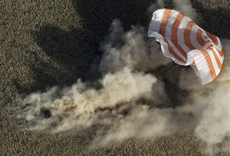 The Soyuz spacecraft carrying Russian cosmonauts Vinogradov and Misurkin and NASA astronaut Cassidy lands near the town of Zhezkazgan