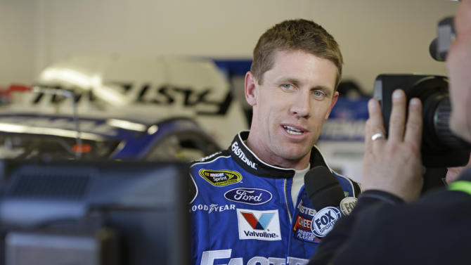 Driver Carl Edwards watches the replay on a TV monitor of a wreck that he was involved in during practice for the NASCAR Sprint Unlimited Shootout auto race at Daytona International Speedway, Friday, Feb. 15, 2013, in Daytona Beach, Fla. (AP Photo/John Raoux)