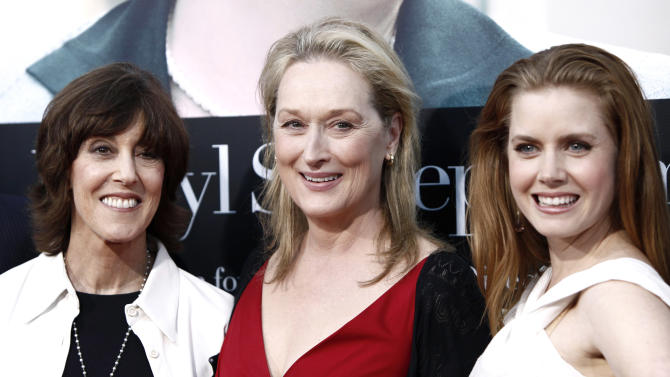 """FILE - This July 27, 2009 file photo shows director and writer Nora Ephron, left, and cast members Meryl Streep, center, and Amy Adams pose together at the premiere of """"Julie and Julia"""" in Los Angeles. Publisher Alfred A. Knopf confirmed Tuesday, June 26, 2012, that author and filmmaker Nora Ephron died Tuesday of leukemia in New York. She was 71. (AP Photo/Matt Sayles, file)"""