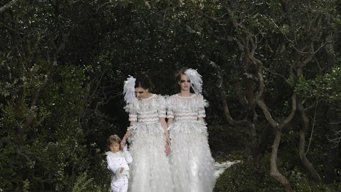 Models wear wedding gowns by German fashion designer Karl Lagerfeld for Chanel's Spring Summer 2013 Haute Couture fashion collection, presented in Paris, Tuesday, Jan.22, 2013. (AP Photo/Christophe Ena)