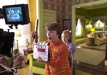Spencer Breslin and Dakota Fanning on the set of Universal's Dr. Seuss' The Cat In The Hat