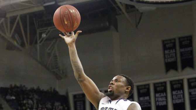 Pittsburgh's Nasir Robinson (35) goes over Cincinnati's Jaquon Parker (44) to score in the first half of an NCAA college basketball game Sunday, Jan. 1, 2012, in Pittsburgh. (AP Photo/Keith Srakocic)