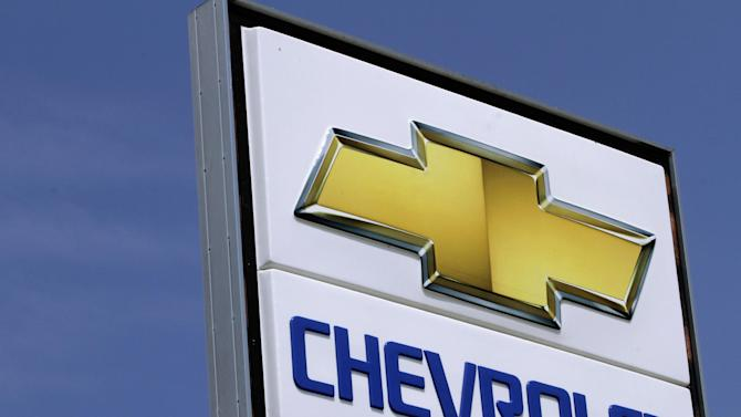 This  July 8, 2012 , photo shows the Chevrolet logo at an auto dealership in Springfield, Ill. A turnaround in South America and a rosier outlook in Europe helped push General Motors shares up Wednesday, July 31, 2012, even though the company's third-quarter net profit fell 14 percent. GM said it earned $1.48 billion from July through September, down from $1.73 billion a year earlier, as European pretax losses widened and North American profits fell. (AP Photo/Seth Perlman)