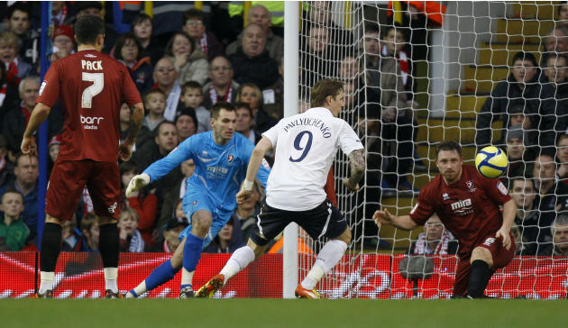 Tottenham Hotpurs' Roman Pavlyuchenko, center, scores against Cheltenham Town during their English FA Cup third round soccer match at White Hart Lane Stadium in London, Saturday Jan. 7, 2012. (AP Phot
