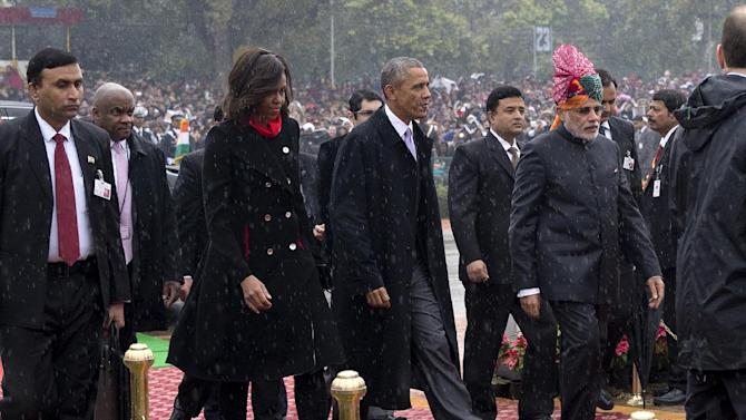 U.S. President Barack Obama, second right, and first lady Michelle Obama, second left, are greeted by Indian Prime Minister Narendra Modi, right, as they arrive for Republic Day in New Delhi, India, Monday, Jan. 26, 2015. Obama on Monday took in a grand display of Indian military hardware, marching bands and elaborately dressed camels, becoming the first American leader to be honored as chief guest at India's annual Republic Day festivities. (AP Photo/Carolyn Kaster)