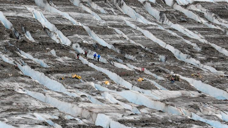 a recovery team works at the site where military aircraft wreckage was found on Colony Glacier