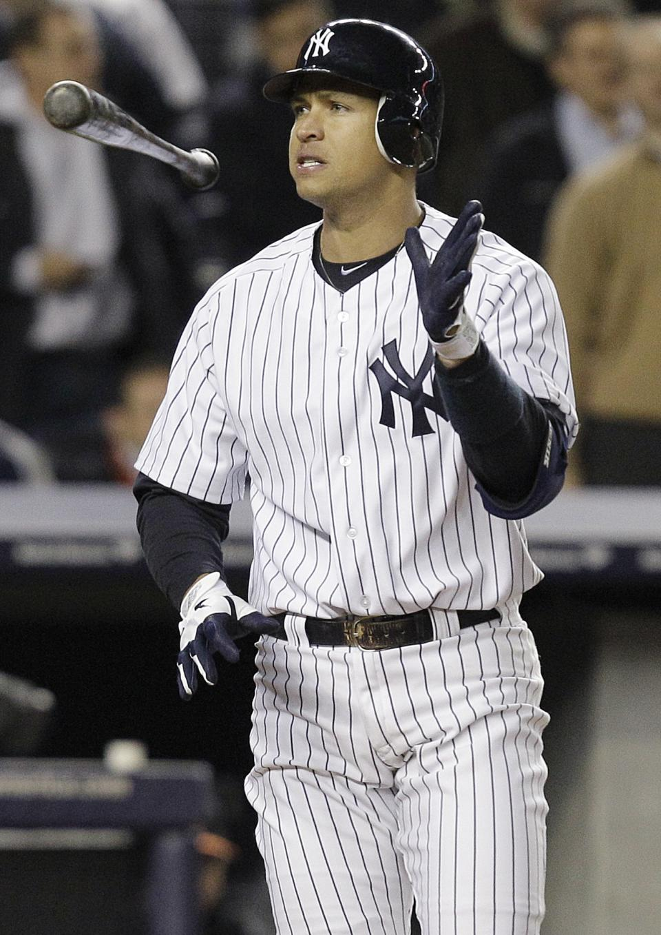 New York Yankees' Alex Rodriguez tosses his bat after striking out to end the sixth inning of Game 4 of the American League division baseball series against the Baltimore Orioles, Thursday, Oct. 11, 2012, in New York. (AP Photo/Kathy Willens)