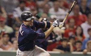 Carroll's single in 10th lifts Twins over Red Sox