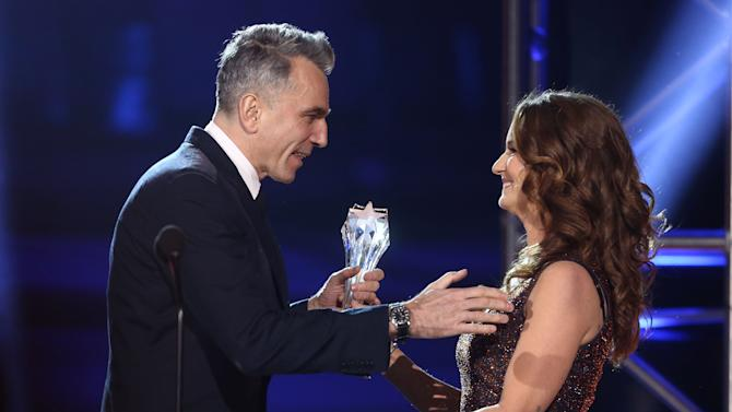 Melissa Leo, right, presents the award for best actor to Daniel Day-Lewis at the 18th Annual Critics' Choice Movie Awards at the Barker Hangar on Thursday, Jan. 10, 2013, in Santa Monica, Calif.  (Photo by Matt Sayles/Invision/AP)
