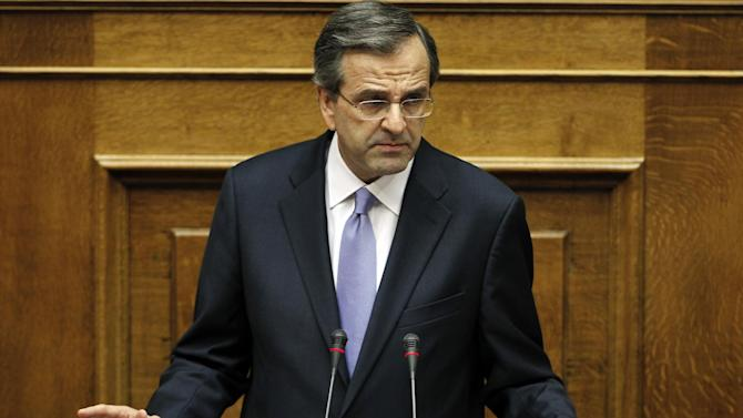 New Greek Prime Minister Antonis Samaras presents his government's policy platform at the parliament in Athens on Friday, July 6, 2012. Greece's Prime Minister Antonis Samaras says his new three-party coalition government is ready to carry out a broad series of structural reforms, and acknowledges the country's deficit reduction program has gone off target. (AP Photo/Kostas Tsironis)