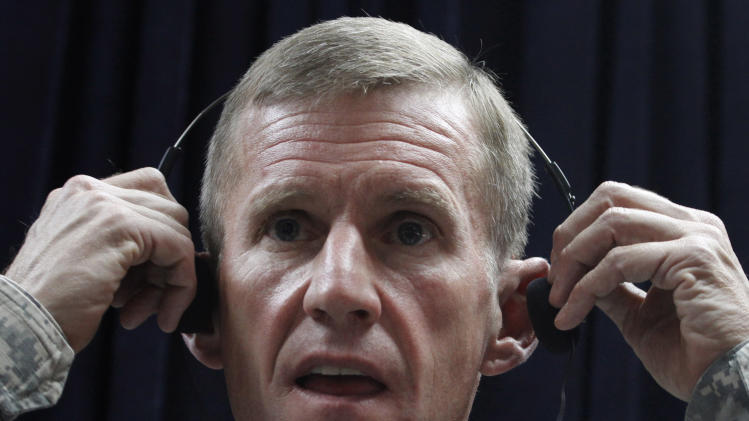FILE - In this Sunday, May 30, 2010 file photo, U.S. Gen. Stanley McChrystal, then top commander of U.S. and NATO forces in Afghanistan, adjusts his headphone during a news conference in Kabul, Afghanistan. McChrystal was fired after his scathing remarks about America's civilian leadership. Nearly two dozen generals have commanded troops from the United States and the NATO-led International Security Assistance Force, since the American invasion in late 2001. While some analysts say fresh eyes are important, others wonder if the revolving door command has hurt U.S. continuity with critical Afghan partners. (AP Photo/Musadeq Sadeq, File)