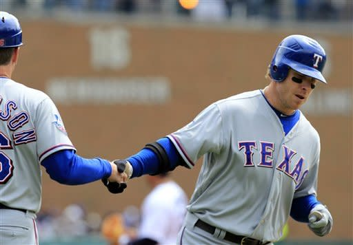 Rangers take lead on missed call, edge Tigers 3-2