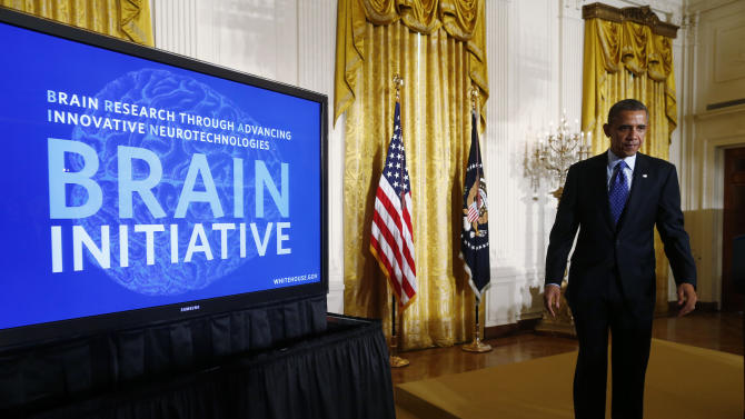 President Barack Obama leaves the stage in the East Room of the White House in Washington, Tuesday, April 2, 2013, after he spoke about the BRAIN (Brain Research through Advancing Innovative Neurotechnologies) Initiative. (AP Photo/Charles Dharapak)