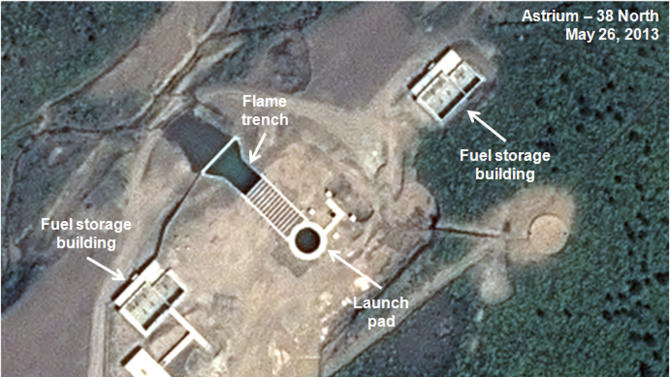 This May 26, 2013 satellite image taken by Astrium, and annotated and distributed by 38 North shows an unfinished new launch pad, center, at the Tonghae facility in North Korea. An eight-month construction standstill at the North Korean site meant to launch bigger and better long-range rockets may signal Pyongyang is slowing or even stopping development of larger rockets, according to a new analysis of recent satellite imagery. (AP Photo/Astrium - 38 North) CREDIT MANDATORY