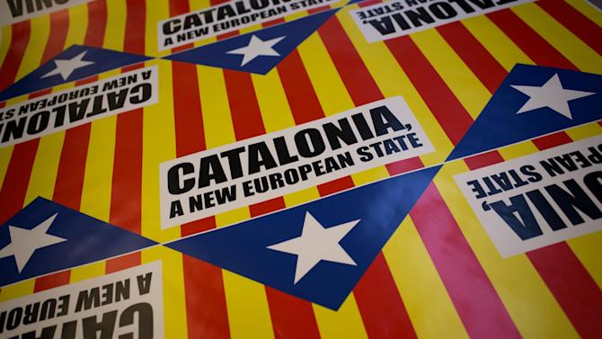 "In this photo taken on Tuesday, Nov. 13, 2012, flags for sale that combines the slogan of EU aspiration with the red-and-yellow stripes, blue triangle and white star of the ""estelada"" flag that symbolizes Catalonia's independence drive are laid out in a printing shop in Girona, Spain. Catalonia holds elections on Sunday that will be seen as a test of the regional government's plans to hold a referendum on independence, and one of the key issues emerging is the theoretical place of a free Catalonia in Europe. (AP Photo/Emilio Morenatti)"
