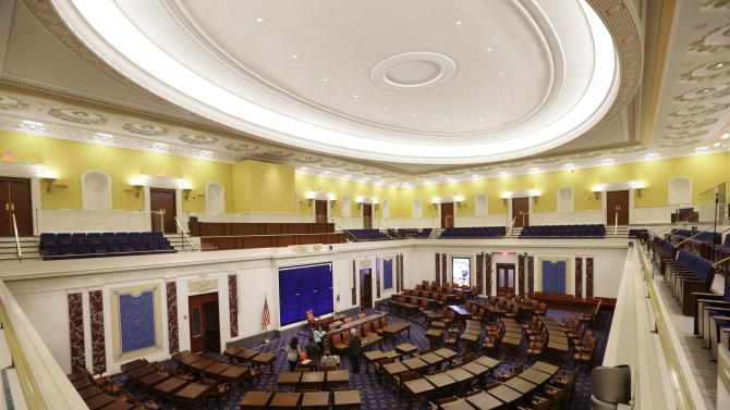 In this Monday, March 23, 2015 photo, a full-scale replica of the U.S. Senate Chamber is displayed inside the Edward M. Kennedy Institute, in Boston. The $79 million institute is scheduled to be dedicated on Monday, March 30, 2015. (AP Photo/Steven Senne)