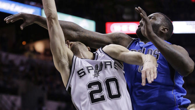 San Antonio Spurs' Manu Ginobili (20), of Argentina, is fouled hard by Dallas Mavericks' DeJuan Blair (45) during the first half of Game 7 of the opening-round NBA basketball playoff series, Sunday, May 4, 2014, in San Antonio. Blair was awarded a flagrant foul on the play