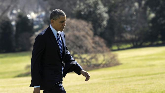 President Barack Obama walks off of Marine One on the South Lawn of the White House in Washington, Wednesday, Feb. 6, 2013, after returning from a Democratic retreat in Annapolis, Md. (AP Photo/Susan Walsh)