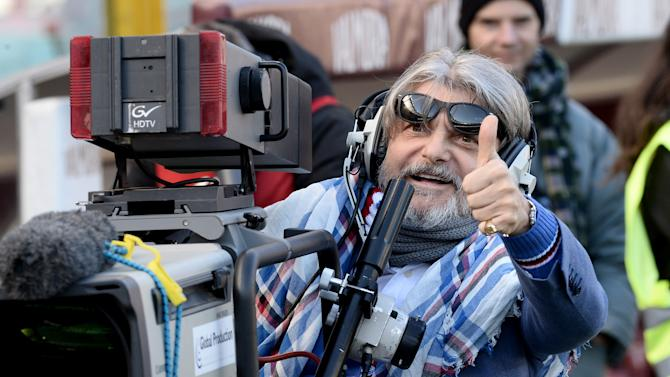 Sampdoria President Massimo Ferrero uses a television camera during a Serie A soccer match between Torino and Sampdoria at the Olympic stadium, in Turin, Italy, Sunday, Feb. 1, 2015. (AP Photo/ Massimo Pinca)