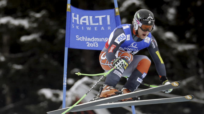 United States' Andrew Weibrecht takes a jump during the men's downhill, at the Alpine skiing world championships in Schladming, Austria, Saturday, Feb.9, 2013. (AP Photo/Luca Bruno)