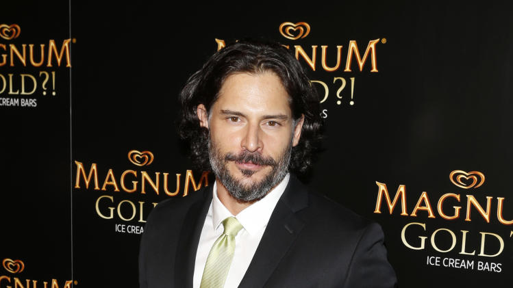 IMAGE DISTRIBUTED FOR MAGNUM - Actor Joe Manganiello arrives on the gold carpet of the As Good As Gold premiere, a new short film starring Joe Manganiello that celebrates the U.S. arrival of MAGNUM Gold?! Ice Cream. The film debuted during the Tribeca Film Festival Thursday, April 18, 2013 in New York. Visit MagnumIceCream.com for more information  (Photo by Jason DeCrow/Invision for MAGNUM/AP Images)