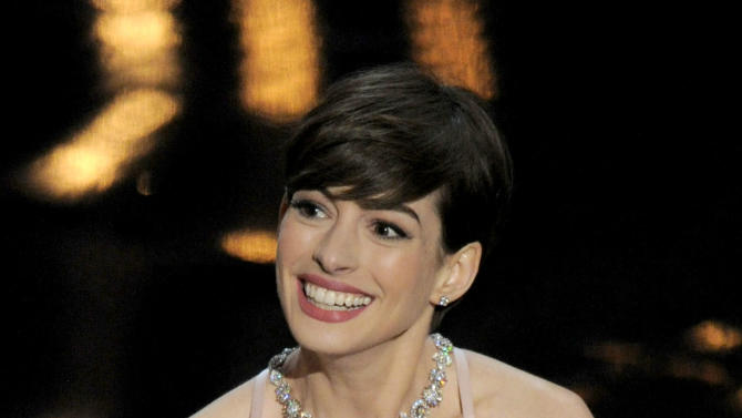 "Anne Hathaway accepts the award for best actress in a supporting role for ""Les Miserables"" during the Oscars at the Dolby Theatre on Sunday Feb. 24, 2013, in Los Angeles.  (Photo by Chris Pizzello/Invision/AP)"