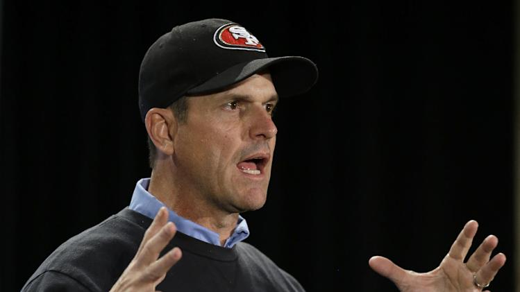 San Francisco 49ers head coach Jim Harbaugh talks with reporters during a news conference on Sunday, Jan. 27, 2013, in New Orleans. The 49ers will face the Baltimore Ravens in the NFL Super Bowl XLVII football game on Feb. 3. (AP Photo/Mark Humphrey)