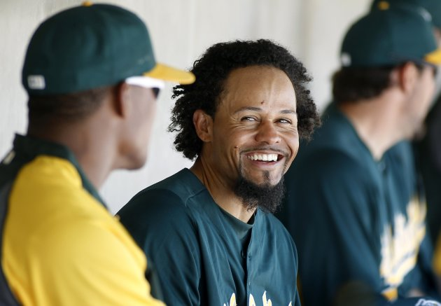 Athletics' Crisp laughs with teammate during their MLB Cactus League spring training game against the Royals in Phoenix