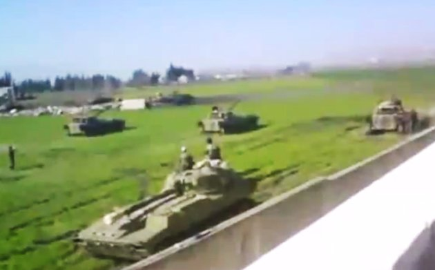 This image made from amateur video released by the Shaam News Network and accessed Sunday, June 24, 2012, purports to show Syrian military tanks in Hama, Syria. (AP Photo/Shaam News Network via AP video) TV OUT, THE ASSOCIATED PRESS CANNOT INDEPENDENTLY VERIFY THE CONTENT, DATE, LOCATION OR AUTHENTICITY OF THIS MATERIAL