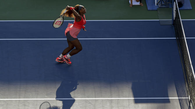Serena Williams returns a shot to Li Na, of China,during the semifinals of the 2013 U.S. Open tennis tournament, Friday, Sept. 6, 2013, in New York. (AP Photo/Mike Groll)