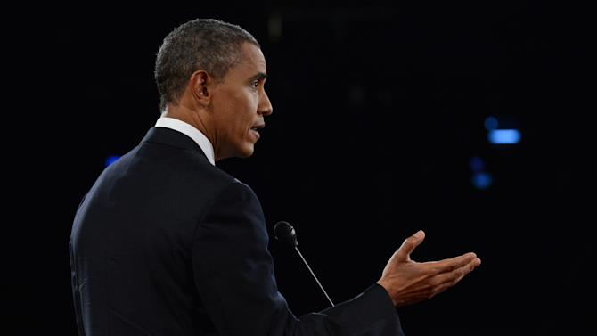 President Barack Obama answers a question during the first presidential debate at the University of Denver, Wednesday, Oct. 3, 2012, in Denver. (AP Photo/Pool-Michael Reynolds)