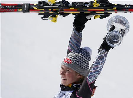 Shiffrin of the US holds up the women's Slalom trophy following the season's last race at the Alpine Skiing World Cup finals in Lenzerheide