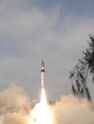 A surface-to-surface Agni V missile is launched from the Wheeler Island off the eastern Indian state of Odisha April 19, 2012. India test-fired the long range missile capable of reaching deep into China and Europe on Thursday, thrusting the emerging Asian power into an elite club of nations with intercontinental nuclear weapons capabilities. A scientist at the launch site said the launch was successful, minutes after television images showed the rocket with a range of more than 5,000 km (3,100 miles) blasting through clouds from the Wheeler Island off Odisha coast. REUTERS/Indian Defence Research and Development Organisation/DRDO/Handout (INDIA - Tags: MILITARY) FOR EDITORIAL USE ONLY. NOT FOR SALE FOR MARKETING OR ADVERTISING CAMPAIGNS. THIS IMAGE HAS BEEN SUPPLIED BY A THIRD PARTY. IT IS DISTRIBUTED, EXACTLY AS RECEIVED BY REUTERS, AS A SERVICE TO CLIENTS