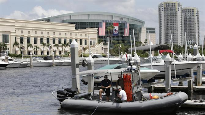 Law enforcement divers inspect the Hillsborough River outside of the Tampa Bay Times Forum where the the Republican National Convention will be held in Tampa, Fla., on Saturday, Aug. 25, 2012. (AP Photo/Dave Martin)