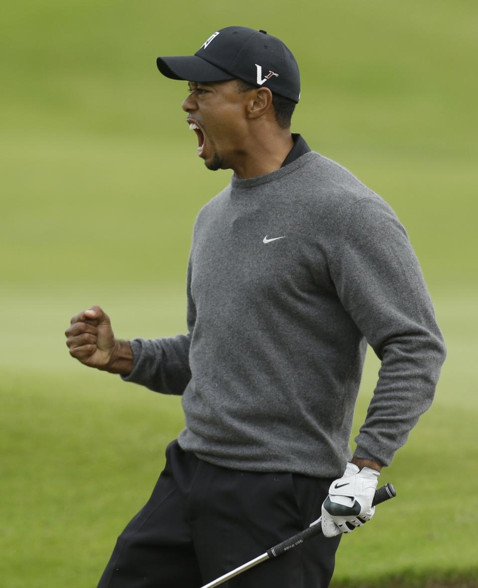 Tiger Woods of the United States reacts after a birdie on the 18th hole at Royal Lytham & St Annes golf club during the second round of the British Open Golf Championship, Lytham St Annes, England, Friday, July 20, 2012. (AP Photo/Jon Super)