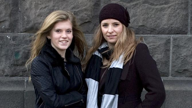 "In this Sunday, Dec. 30, 2012 photo, Blaer Bjarkardottir, 15, left, and her mother, Bjork Eidsdottir, are photographed outside a court building in Reykjavik. Blaer Bjarkardottir is bringing legal action against the Icelandic government to allow her to use her name, which is not on the list of 1,853 government-approved female names. Blaer's mother is supporting her daughter's right to have her name recognized. She said she did not know the name wasn't on the list when she chose it for her daughter. Icelandic law requires names to comply with Icelandic grammar and orthography. The name means ""light breeze"" in Icelandic. There are 1,712 approved male names. (AP Photo/Anna Andersen)"