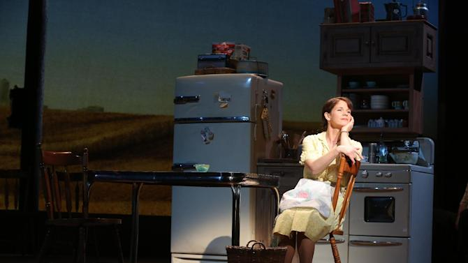 """This image released by Jeffrey Richards Associates shows Kelli O'Hara during a performance of """"The Bridges of Madison County,"""" at the Gerald Schoenfeld Theatre in New York. Producers said Thursday, May 1, 2014, that the show based on Robert James Waller's novel, which was made into a 1995 movie starring Meryl Streep and Clint Eastwood, will close May 18 after just 137 performances. (AP Photo/ Jeffrey Richards Associates, Joan Marcus)"""