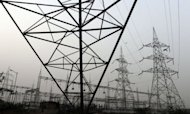 File photo of high voltage electricity towers on the outskirts of New Delhi. A massive power cut blacked out a vast swathe of northern India Monday, leaving an estimated 300 million people without power in the worst outage in more than a decade, officials said