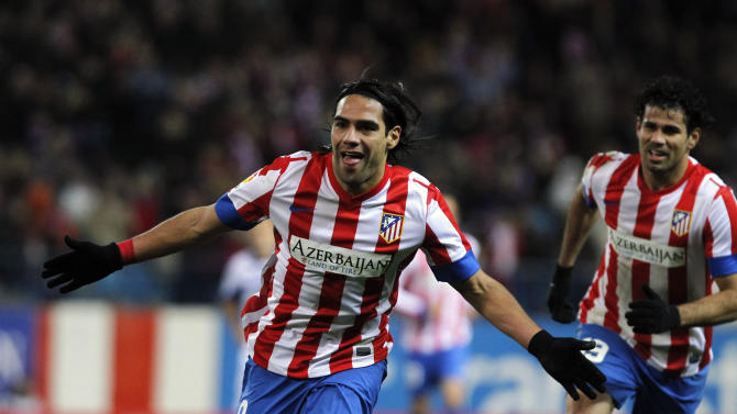 CAPTION CORRECTION, CORRECTS NAME OF OPPOSING TEAM AND OF STADIUM - Atletico de Madrid's Radamel Falcao from Colombia, left, celebrates his goal with Diego Costa from Brazil, right, during a Spanish La Liga soccer match against Deportivo la Coruna at Vicente Calderon Stadium in Madrid, Spain, Sunday, Dec. 9, 2012. (AP Photo/Andres Kudacki)