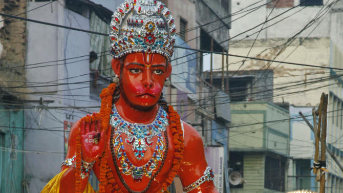 A float carrying Hindu monkey god Hanuman passes through the streets during a Dussehra festival procession in Allahabad, India, Thursday, Oct. 14, 2010. The Dussehra festival commemorates the victory of Rama over Ravana, an evil ruler who had abducted Rama's wife, Sita Devi. Rama killed Ravana to free Sita. The burning of effigies of Ravana, signifying the victory of good over evil, brings the festivities to a close. It will be celebrated on Oct. 17. (AP Photo/Rajesh Kumar Singh)