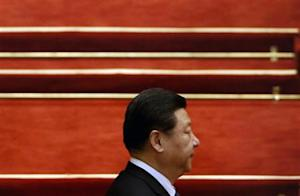 China's President Xi Jinping arrives for the closing ceremony of Chinese National People's Congress (NPC) at the Great Hall of the People, in Beijing, March 13, 2014. REUTERS/Kim Kyung-Hoon