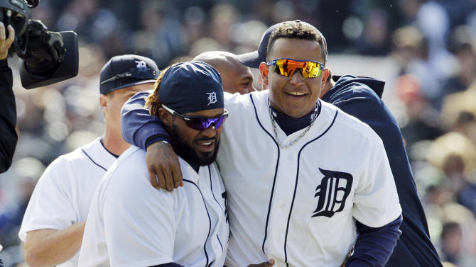 Detroit Tigers' Prince Fielder, left, and Miguel Cabrera walk off the field after their 3-2 win over the Boston Red Sox in a baseball game in Detroit, Thursday, April 5, 2012. (AP Photo/Carlos Osorio)