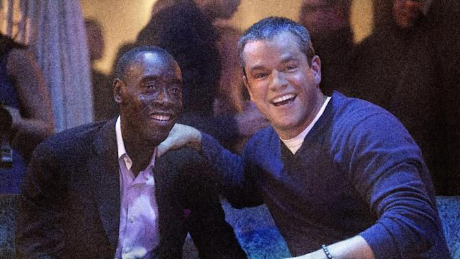 """This publicity photo released by Showtime shows Don Cheadle, left, as Marty Kaan and Matt Damon, as himself, in """"House of Lies,"""" Season 2, Episode 4, on Showtime. Damon is practically becoming a TV comedy regular. Showtime said Damon will guest star next week on """"House of Lies,"""" playing what the channel called a """"maniacal megastar"""" version of himself. (AP Photo/Showtime, Michael Desmond)"""