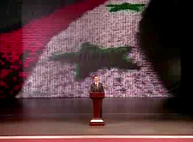 In this image taken from video obtained from Syrian State Television, which has been authenticated based on its contents and other AP reporting, Syrian President Bashar Assad speaks at the Opera House